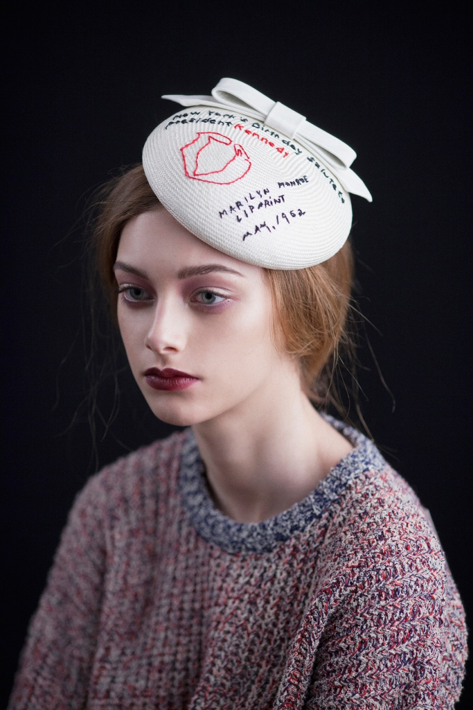 Straw headpiece with handmade embroidery and leather bow